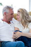 Smart mature couple sitting face to face Stock Photo