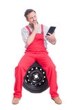 Smart mechanic reading from wireless tablet Stock Photo