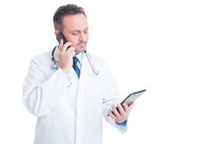 Smart medic or doctor multitasking with phone and tablet Stock Photos