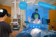 Smart medical with augmented and virtual reality technology concept, medical student use ar and vr for practice the surgery stock images
