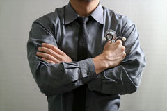 Smart medical doctor across his arms, Stock Photography