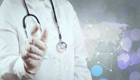 Smart medical doctor hand showing network with bokeh exposure as Royalty Free Stock Images