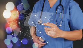 Smart medical doctor hand showing network with bokeh exposure as Stock Images