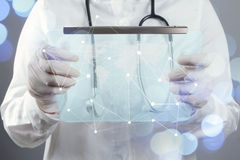 Smart medical doctor hand showing network with bokeh exposure as Stock Photos
