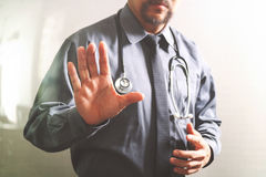 Smart medical doctor opening his hand, touch screen computer,ste Stock Image
