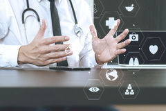 Smart medical doctor working with smart phone and digital tablet Stock Images