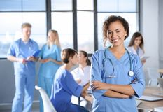 Smart medical student with her classmates. In college royalty free stock photos