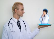 smart medical technology concept, Doctor use augmented technology to connect other doctor to consult, discuss, plan, analysis for stock photos