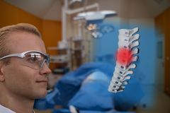 smart medical technology concept, doctor use glasses to use augmented reality to show the injury of spine bone of the patient for royalty free stock photography