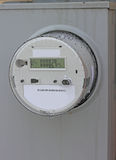 Smart Meter. Newly installed residential power smart meter for electricity by Power Utility Company Stock Photo