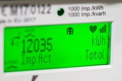 Smart meter digital display. Smart meter close-up of digital display showing units and focus on kilowatt hour and total symbols stock photos