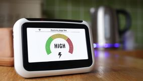 Smart Meter Displaying Electricity Costs as a Kettle is Boiled stock video