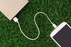 Smart Mobile Phone Charging with Power Bank royalty free stock photos