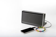 Smart mobile phone connect with portable speaker for playing music Stock Photo