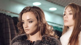 Smart models stands in pose in the rich fur coats for advertising. Slowly stock video