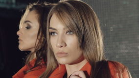 Smart models stands in pose in the rich red coats for advertising. Slowly.  stock video