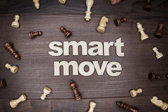 Smart move concept on wooden background Royalty Free Stock Photo