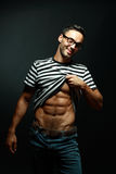 Smart muscular man in glasses Royalty Free Stock Images