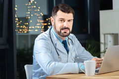 Smart nice doctor looking at you Royalty Free Stock Photos