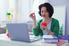 Smart nice woman looking at the candle royalty free stock photography