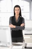 Smart office girl at desk Stock Image
