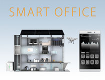 Smart office and smartphone isolated on blue background. The smart offices energy support by solar panel, storage to battery  sys. Tem. Clipping path available Stock Photo