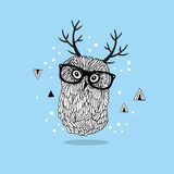 Smart owl in glasses with horns on her head. Stock Photo