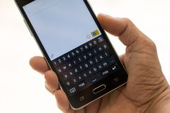 Smart phon and hand  touch on keypad. Hand person touch text on screen keypad Stock Photos