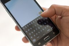 Smart phon and hand  touch on keypad. Hand person touch on keypad Stock Photos