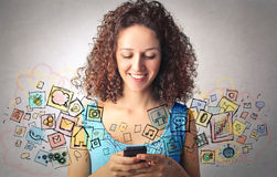 Smart phone apps. Young woman using a smart phone Stock Photography
