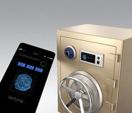 Smart phone authentication app unlock a gold metal safe. Clipping path available Royalty Free Stock Photography