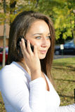 Smart phone autumn woman talking on mobile phone in fall. Stock Photo