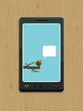 Smart phone bird Royalty Free Stock Photo