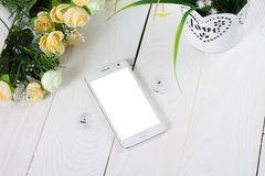 Smart phone with blank screen lying on wooden Royalty Free Stock Image