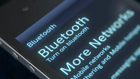 Smart phone Bluetooth Icon Image. A splendid 3d rendering of a smart phone with sparkling inscription Bluetooth More Networks icon. The screen of a phone is Royalty Free Stock Photography
