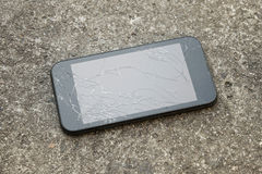 Smart phone with a broken screen. Mobile smart phone with a broken screen stock photography