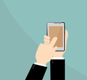 Smart phone on Businessman hand. Royalty Free Stock Images