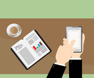 Smart phone on Businessman hand and white mug of coffee on desk. Royalty Free Stock Image