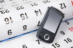 Smart Phone on Calendar Stock Photo