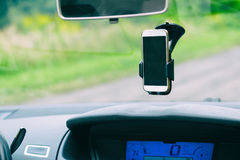 Smart phone in the car holder Stock Photography