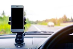 Smart phone in car It`s arranged to put your pictures and information. Stock Images