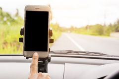 Smart phone in car It`s arranged to put your pictures and information. Stock Photography