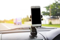 Smart phone in car It`s arranged to put your pictures and information. Stock Photo