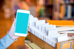 Smart phone with card catalogue Royalty Free Stock Photos