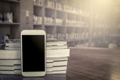 Smart phone,cellphone with stack of book Stock Photos