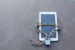 Smart phone with chain and lock for safety and security concept.  royalty free stock photography