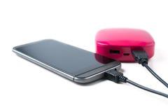Smart phone charging Stock Image