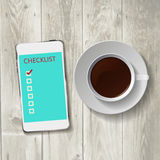 Smart phone with check list Royalty Free Stock Photos