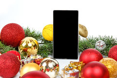 Smart phone and Christmas decoration Royalty Free Stock Image