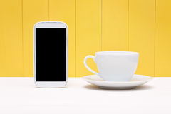 Smart phone with coffee cup Stock Photos